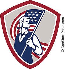 Amerikanischer Patriot mit US-Flaggeschild.
