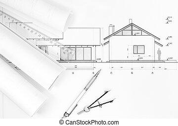 Architekturpläne und Zeichnungsinstrumente.