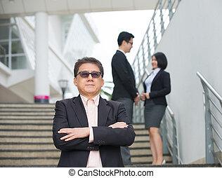 Asiatisches Geschäftsteam.