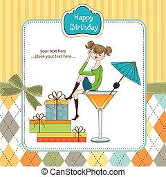 Attraktives junges Mädchen sitzt am Rande eines Glases. Glamouröse Geburtstagskarte