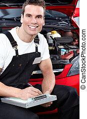 Automechaniker mit Tablet.