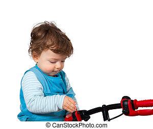 baby- junge, seine, spielende , fahrrad