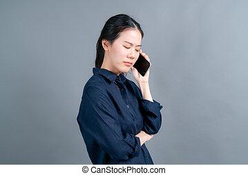 beweglich, gebrauchend, sprechende , asiatische frau, geschäftstelephon
