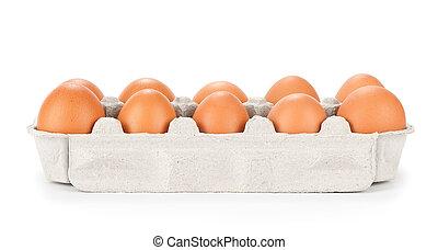 Braune Eier in einem Karton