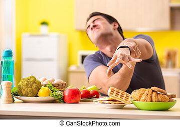 Der Mensch hat eine schwere Wahl zwischen gesundem und ungesundem Essen.