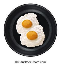 Eier in einer Pfanne isoliert.