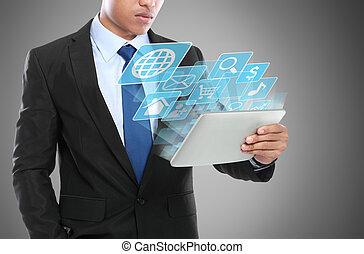 Ein Geschäftsmann mit Tablet PC