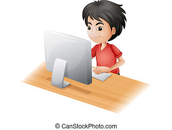 Ein Junge, der den Computer benutzt