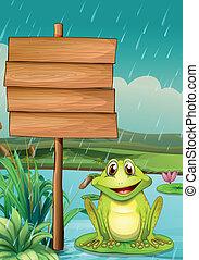 Ein leeres Brett mit einem grünen Frosch