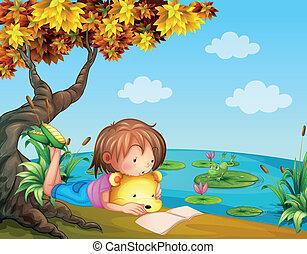Ein Mädchen, das neben dem Fluss liest