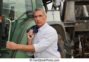 Ein Mann mit Traktor