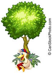 Eine Ente, die unter dem Baum liest.