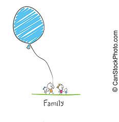 Eine glückliche Familie mit einem Ballon