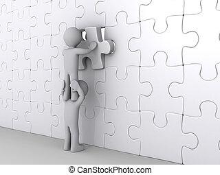 Eine Person auf einem anderen, die ein letztes Puzzlestück steckt