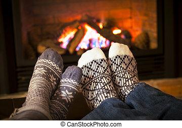 Füßewärmen durch Kamin
