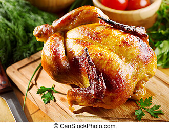 Ganz gebratenes Hühnchen.