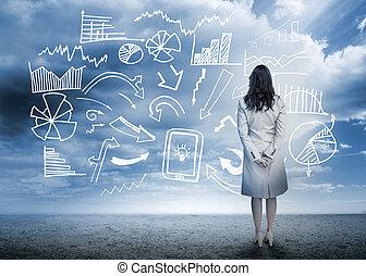 Geschäftsfrau steht vor dem Datenfluss