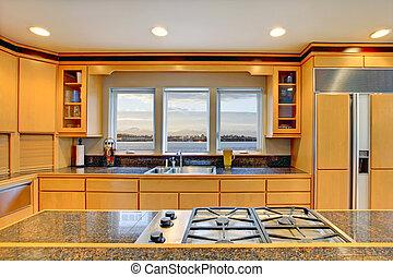 Große luxuriöse moderne Holzküche mit Granitplatten.