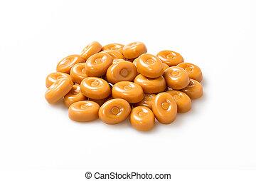 gruppe, süßigkeiten, aus, zuckerl, stapel, hintergrund., form, karamell, closeup, kreis, weißes