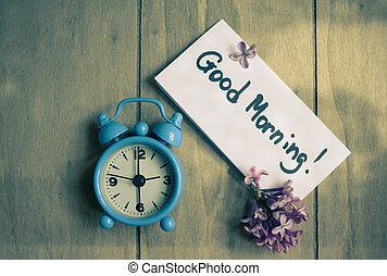 Guten Morgen und alte Uhr.