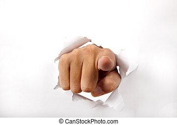 Hand brechen durch das weiße Papier mit dem Finger auf dich.