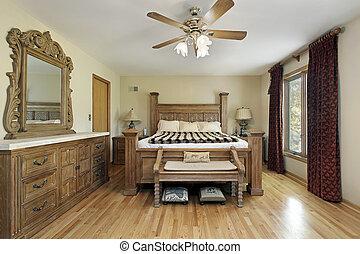 Hauptschlafzimmer mit Eichenholzmöbeln