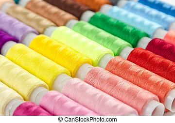 Hintergrund von Bobbs mit mehrfarbigem Faden.