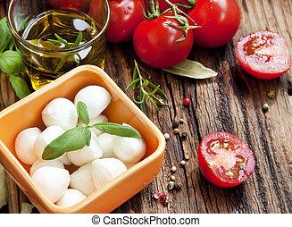 Italienische Zutaten, Mozzarella, Basilikum und Kirsch-Tomat.
