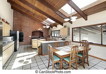 Küche mit Holzdecke und Dachfenstern