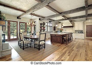 Küche mit Insel- und Deckenholzstrahlen