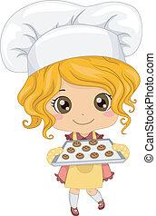 Kleines Mädchen, das Kekse backt