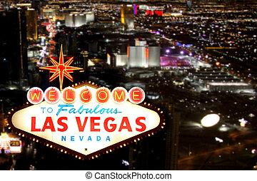 Las Vegas Willkommensschild mit Nachtschicht im Hintergrund