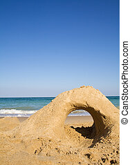 Leer Strand mit Sandburg