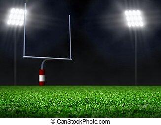 Leeres Fußballfeld mit Rampenlicht.