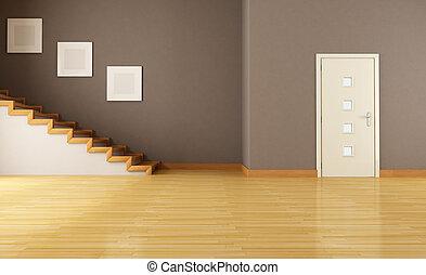 Leeres Innere mit Tür und Treppe