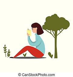 Mädchen lesen unter dem Baum
