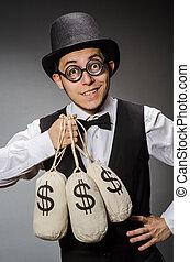 Mann mit Geldsäcken.