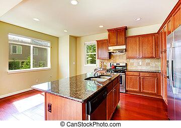 Moderne Küche mit Insel und Granitspitzen.