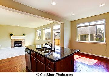 Moderne Kücheninsel mit Granit.