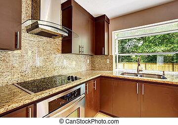 Modernes Küchenzimmer mit mattbraunen Schränken und Granit trim.