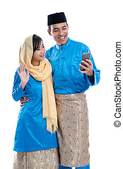 moslem, paar, gebrauchend, handy