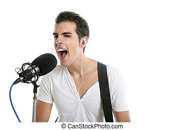 Musiker, junger Mann, der elektrische Gitarre spielt.