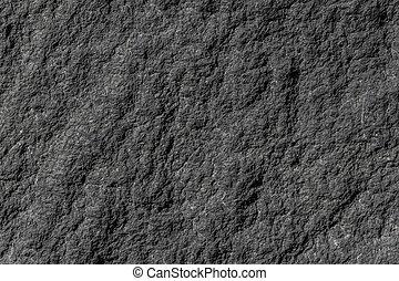 Natursteingranitwand mit rauer Struktur.