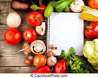 Offenes Notizbuch und frisches Gemüse Hintergrund. Diät