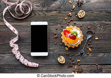 orange, smartphone, schmackhaft, erdbeer, erdnüsse, auf., pfirsich, begriff, anis, -, rustic, schneiders, bohnen, gepeitscht, torte, bohnenkaffee, guten, nachtisch, ruler., diät, fruechte, hintergrund, kiwi, cream., hölzern, sternen, verhöhnen, gewürz, walnuts.