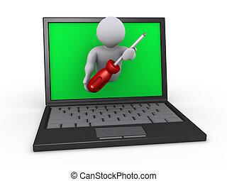 Person mit Schraubenzieher über Laptop