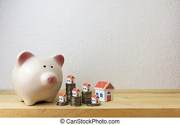 Piggy Bank mit Haus und Münzen.