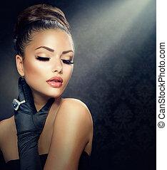 Schönheits-Modelportrait. Ein altmodisches Mädchen mit Handschuhen