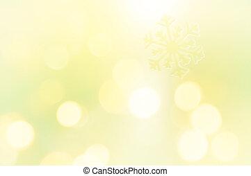 Schneeflocke auf glänzendem gelbem Hintergrund.