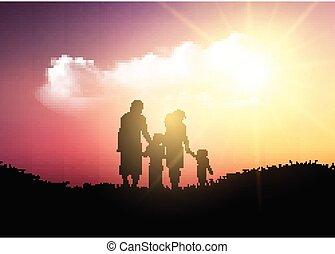 Silhouette einer Familie, die gegen einen Sonnenuntergang läuft.